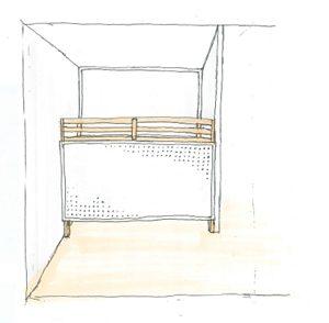 片方からみたベッド。